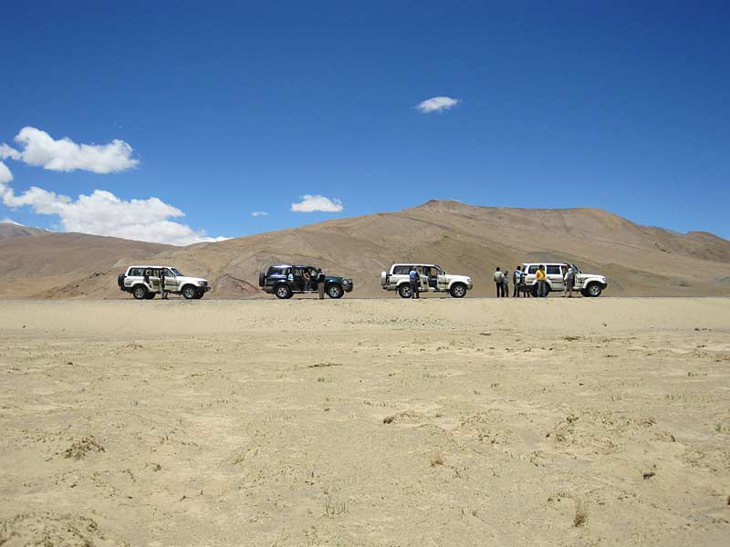 Landcruisers on the road in Tibet