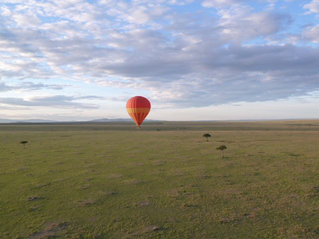 Sunrise hot air balloon flight over the Masai Mara