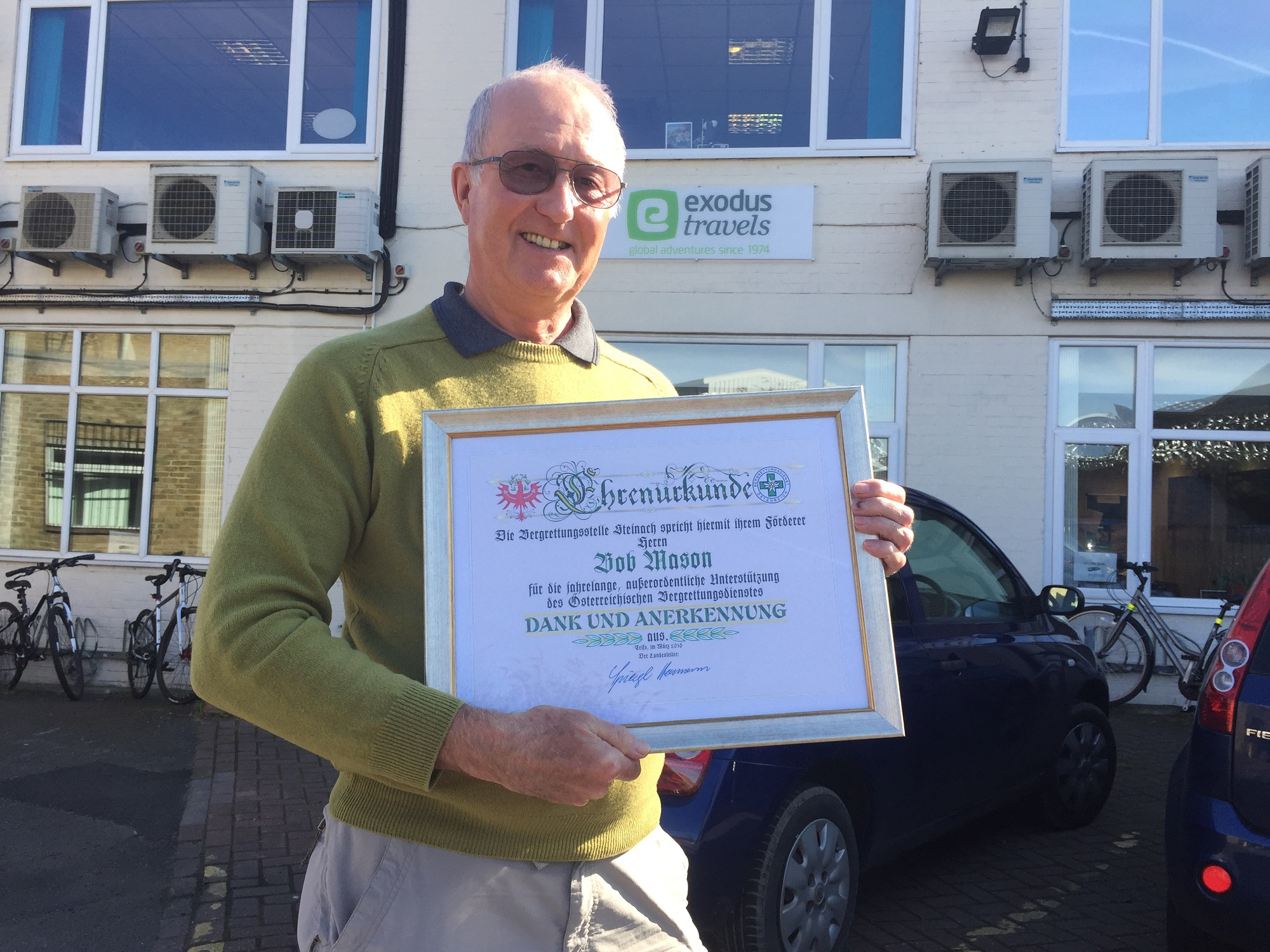Bob at the Exodus office with his certificate