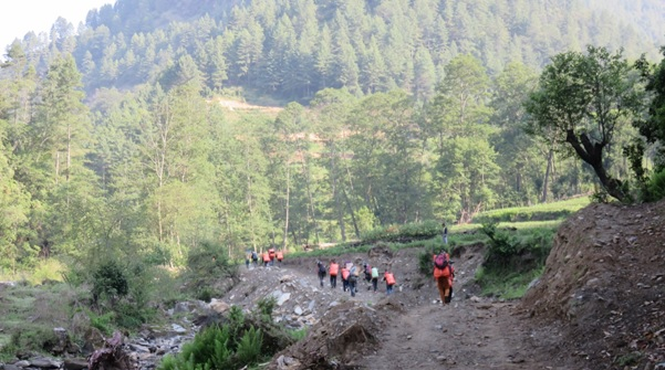 Porters carrying tarpaulins