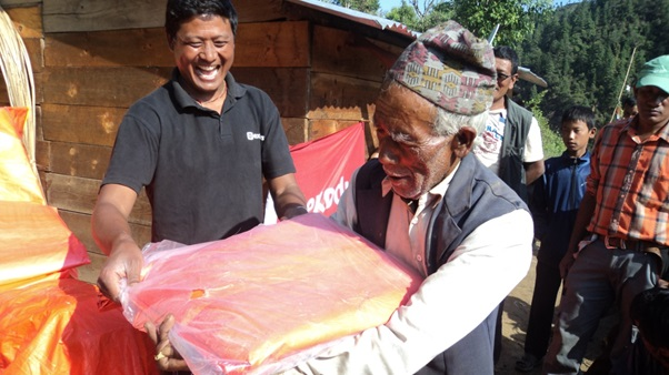 Handing out tarpaulins