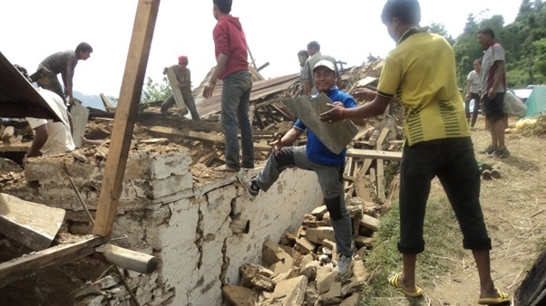 Chandra Khand clearing rubble