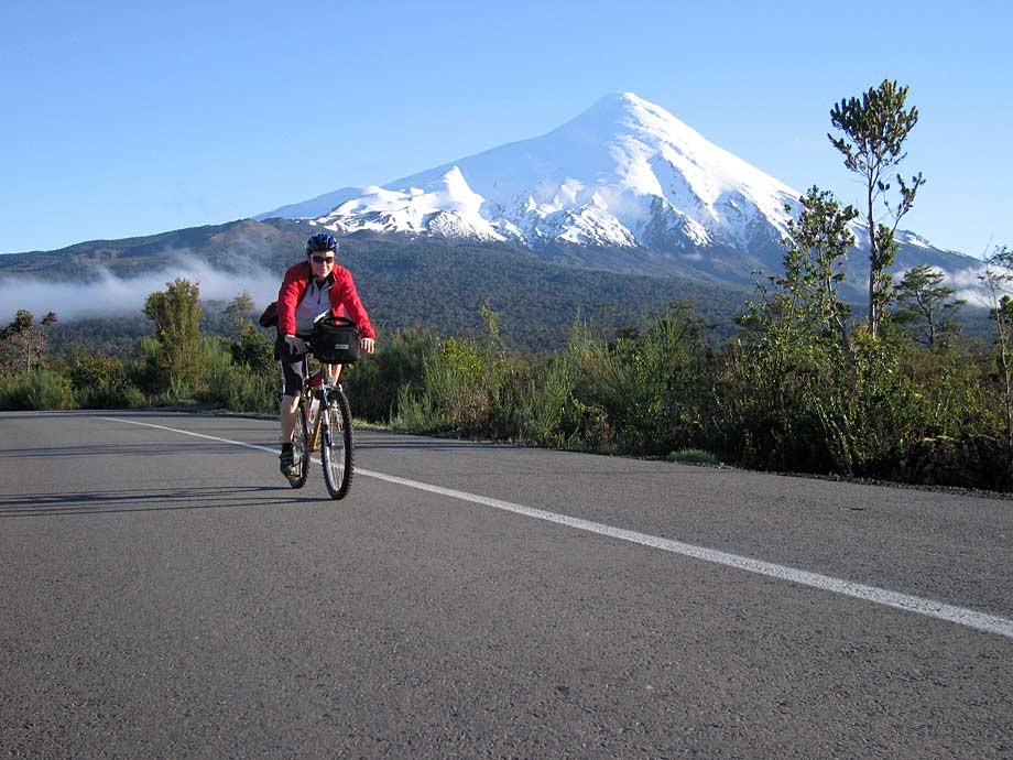 Cycling past Osorno Volcano