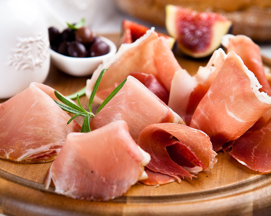 Dry cured ham with olives and fig