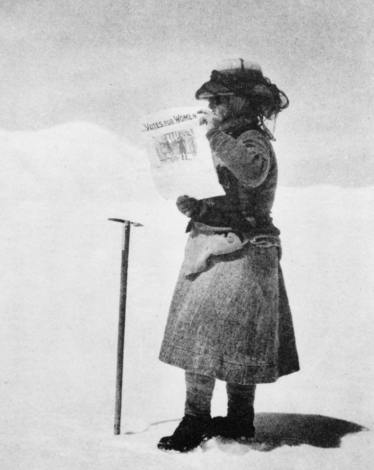 Fanny proudly hoisting her suffragette poster on the Silver Throne Plateau, Karakorum Mounatins