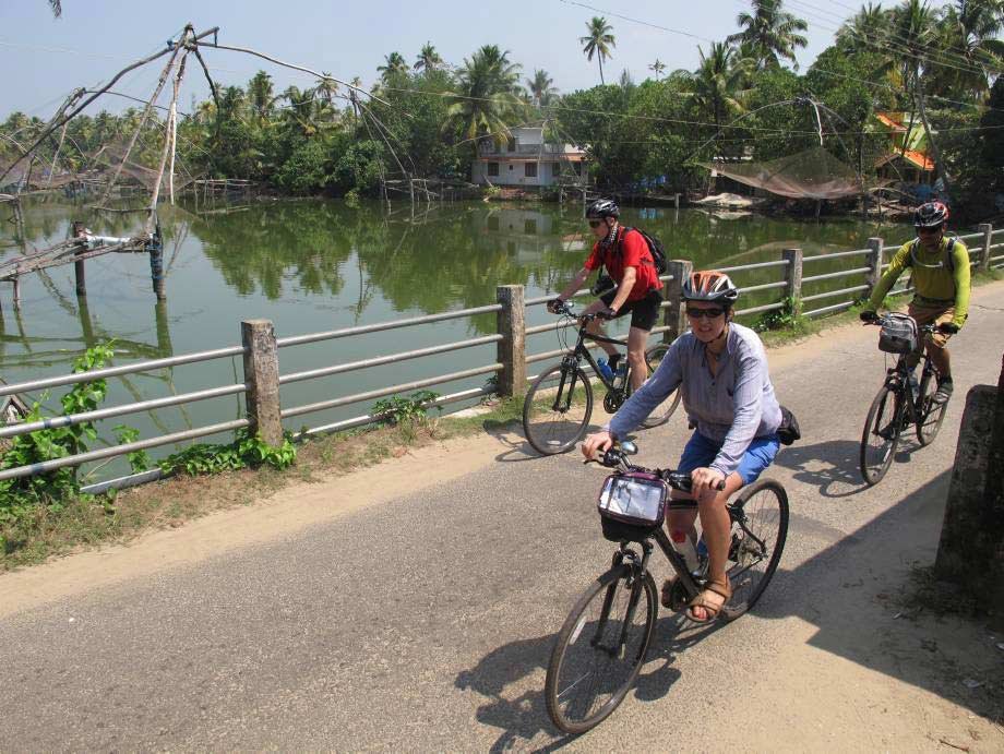 Cyclists crossing bridge, near Cochin