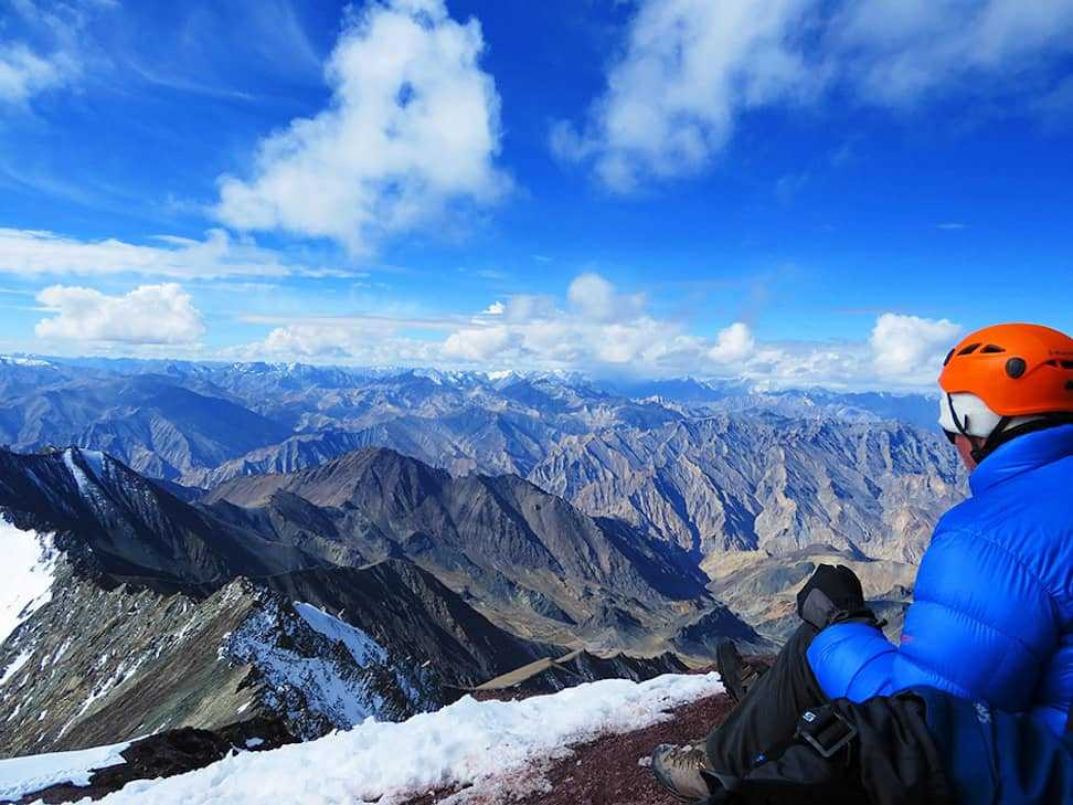 Admiring the panorama from the summit of Stok Kangri