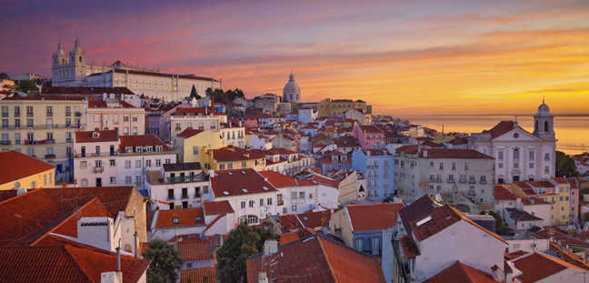Image of Lisbon, Portugal during dramatic sunrise.