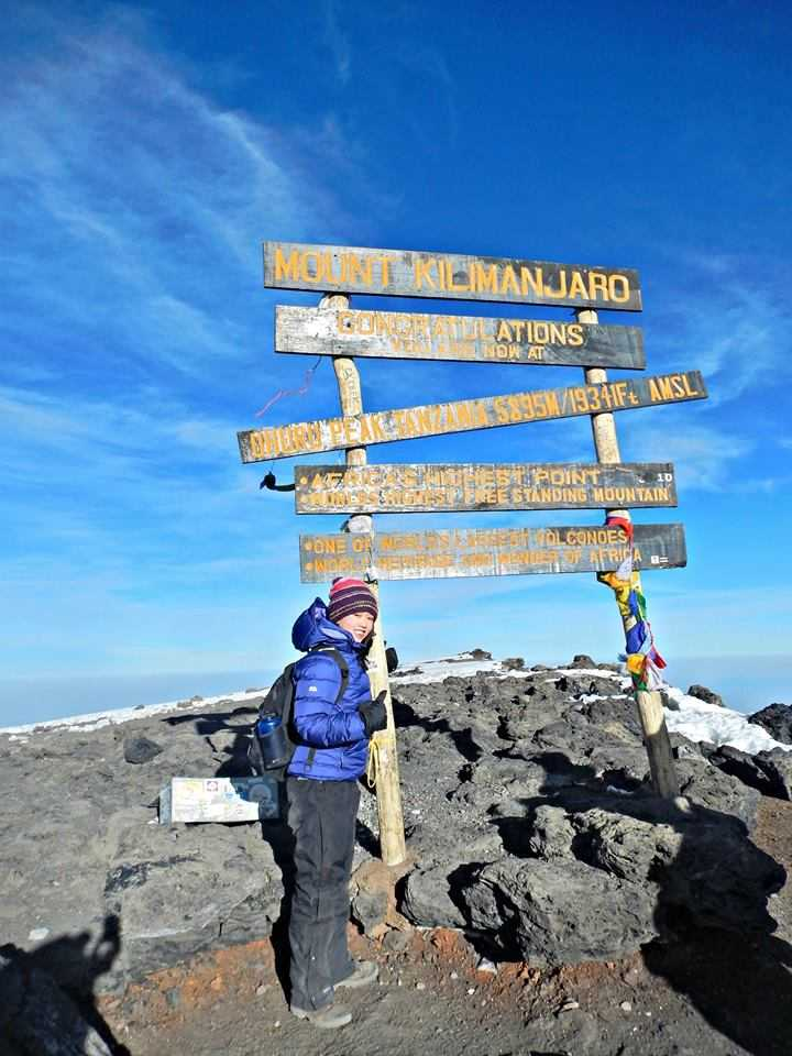 Tailoremade expert Thidara on the summit of Kilimanjaro