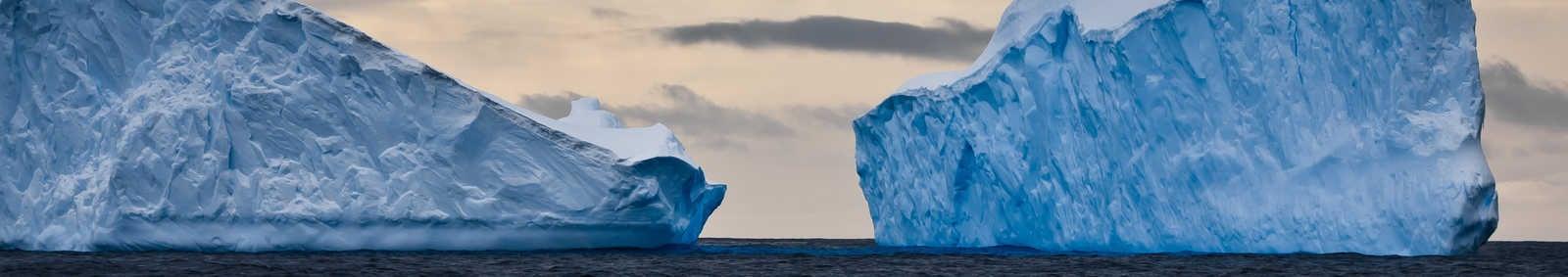 Huge icebergs in Antarctica, dark sky