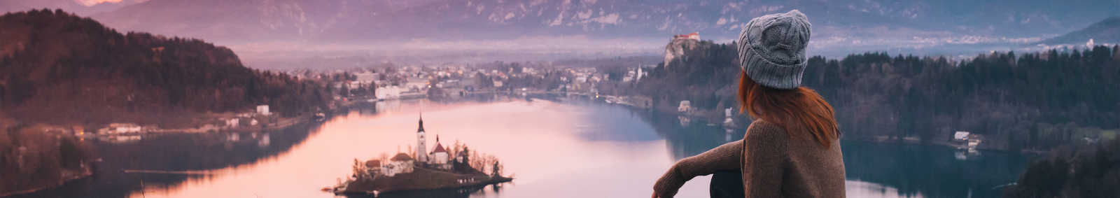 Woman looking on Bled Lake with Island