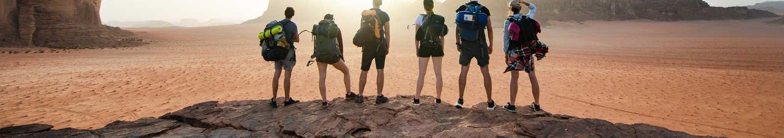 Friends overlooking Wadi rum national park in Jordan