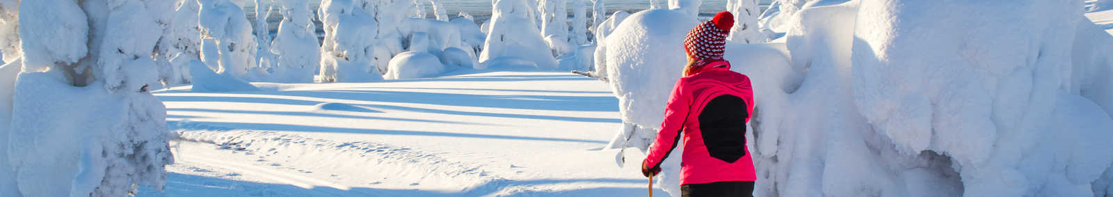Woman cross country skiing in Lapland Finland