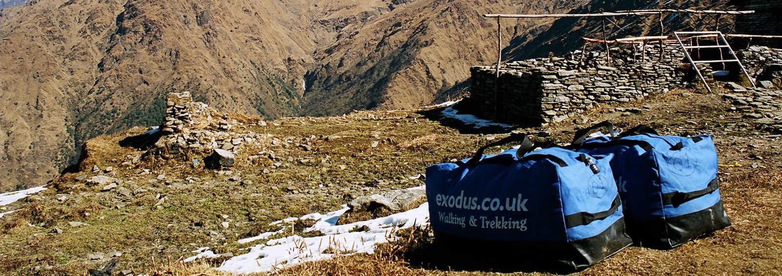 Campsite with kitbags amd peaks, Kopra Ridge, Himalaya