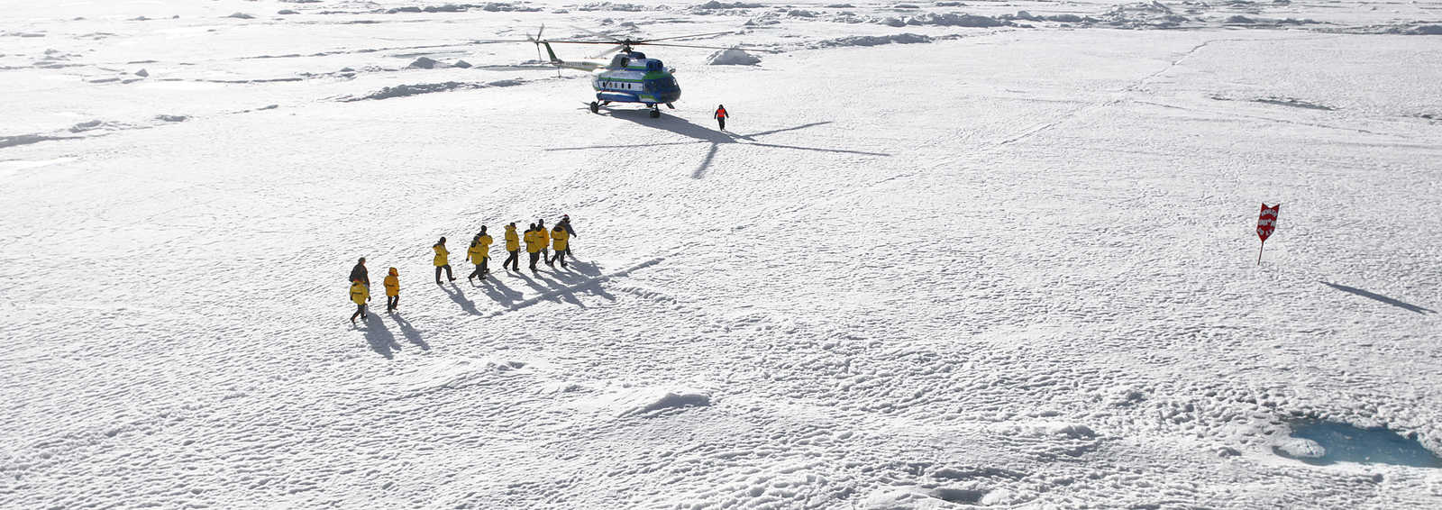 Helicopter and clients at North Pole