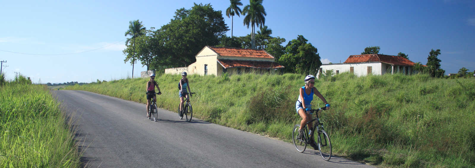 Cyclists on country road, Costa Rica