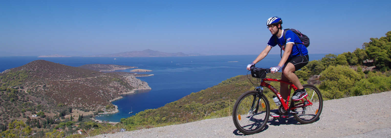 Cyclist on coastal road, Greece