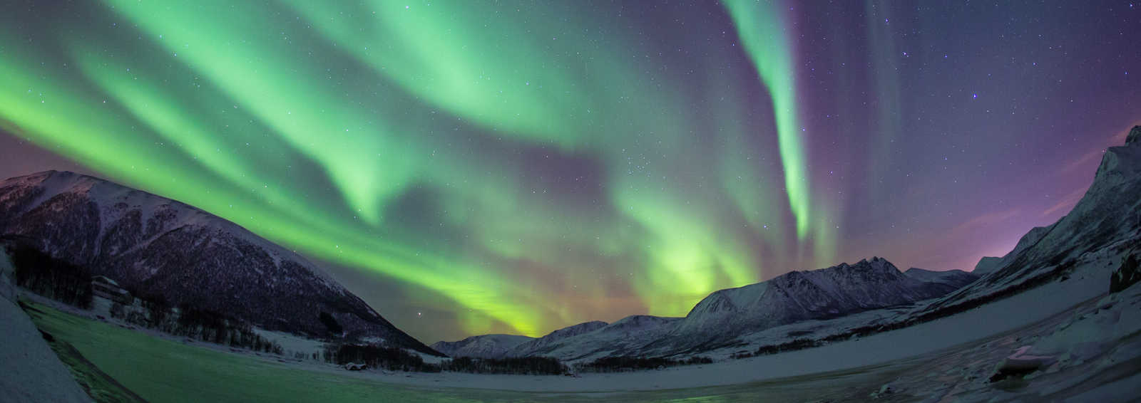 Fabulous Northern Lights over Buknesfjord, seen from the Andoy Friluftssenter