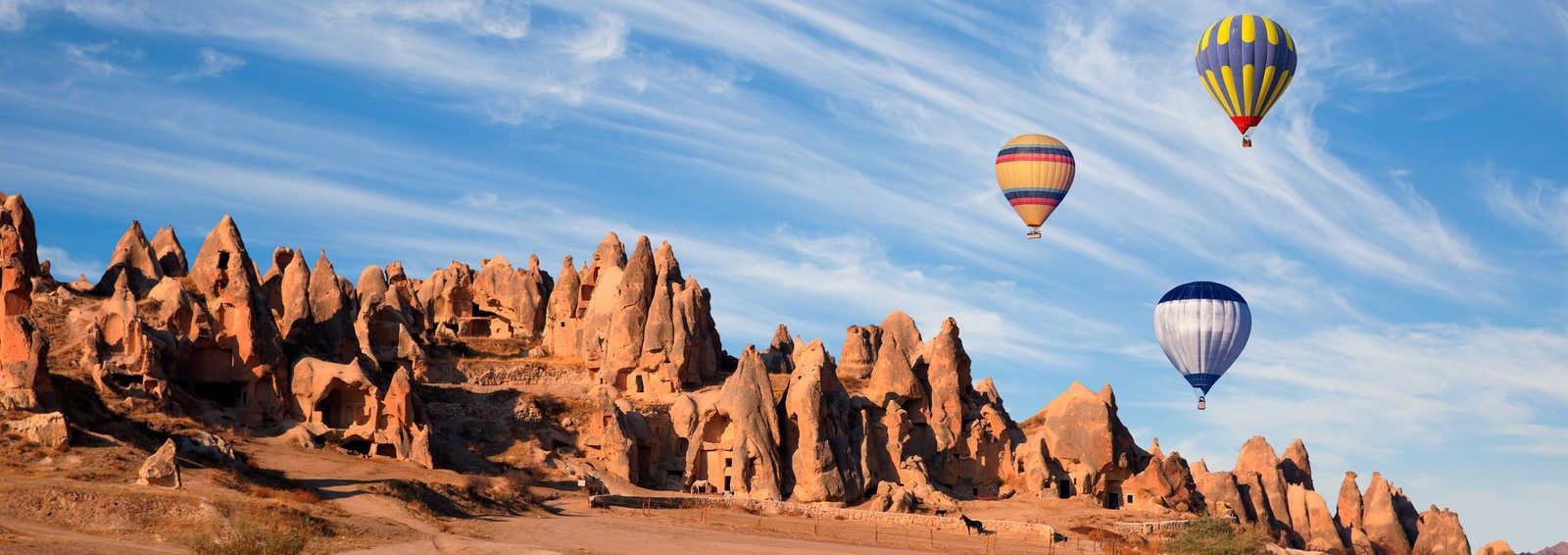 Hot air balloon flying over spectacular Cappadocia, Turkey