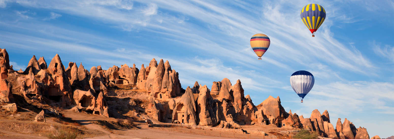 Hot air balloon flying over spectacular Cappadocia, Turkey