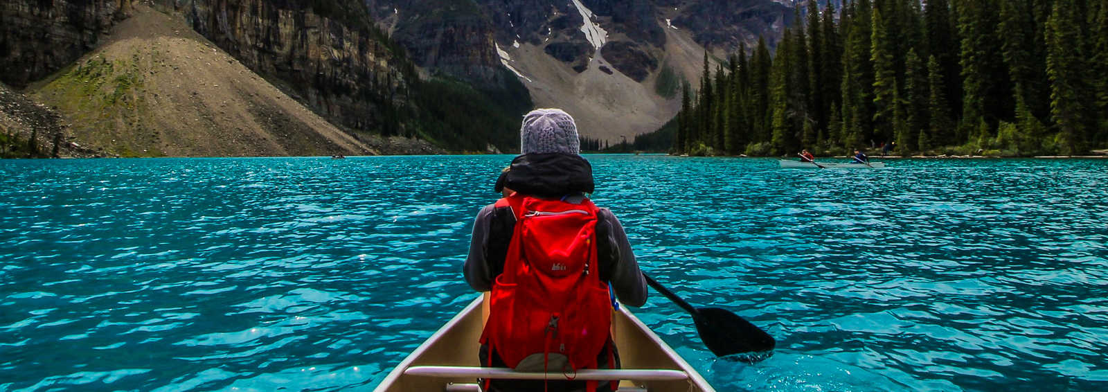 Canoeing on the incredible turquoise water of Moraine Lake, in Banff National Park