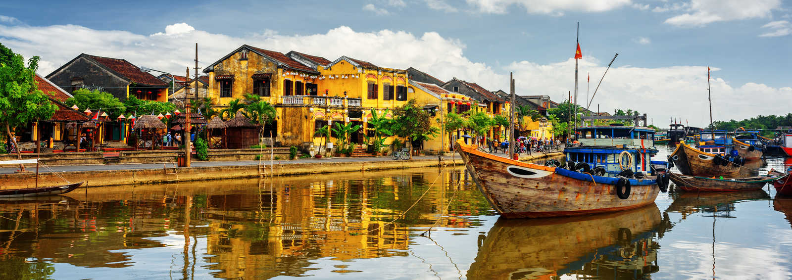 Wooden boats on the Thu Bon River in Hoi An Ancient Town (Hoian), Vietnam.