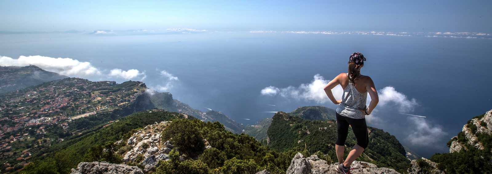 Female adventurer looking out over the Amalfi Coast