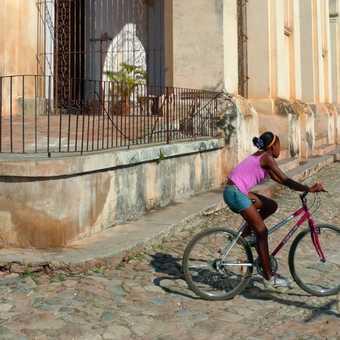 Girl cycling in Trinidad