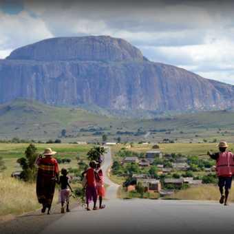 Family walking towards Bishops Hat Rock