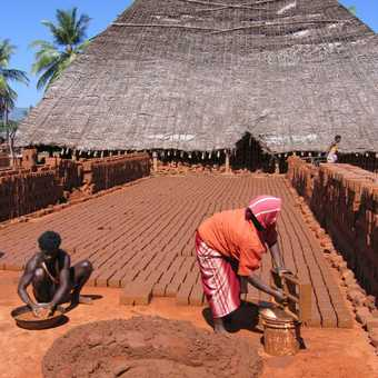Sealing the brick kiln with clay slapped on by hand