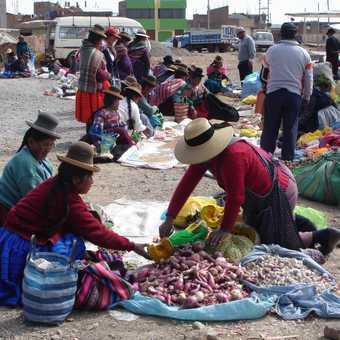 Sunday market at Acora, near Puno. The women wear bowler hats!
