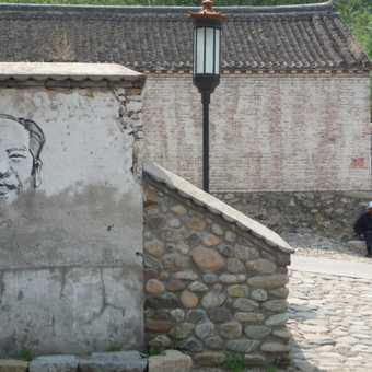 Chairman Mao and a local, times are changing