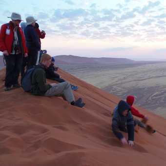 Watching sunrise from Kalahari dune