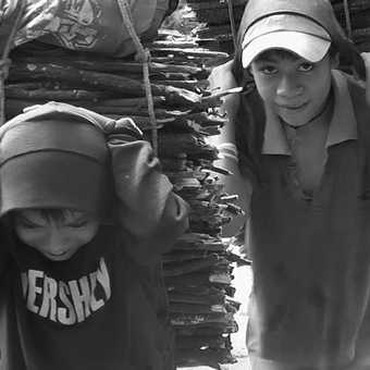 Kids carrying wood
