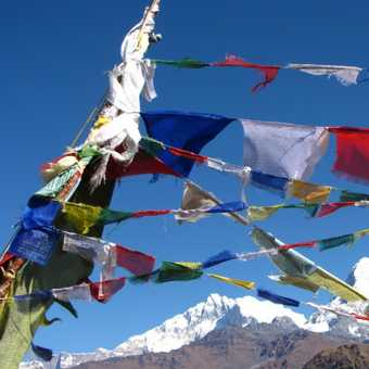 Another set of prayer flags, blue skies and mountains