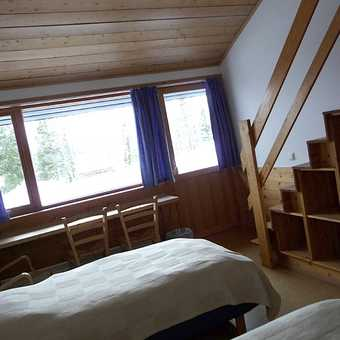 Inside another room with sleeping area above