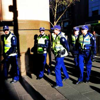 Trainee cops, coming off points duty (traffic),Collins St, Melbourne Australia
