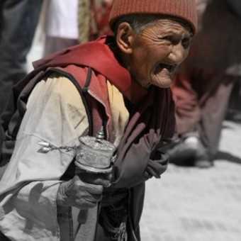 Tibetan woman with prayer wheel