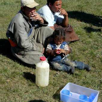 Mongol herders with mare's milk for us to try