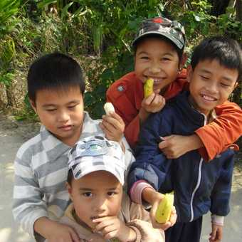 Kids in Hoi An Vietnam - cycling through the residences