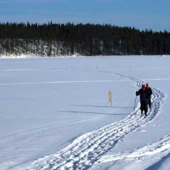 skiing across frozen lake