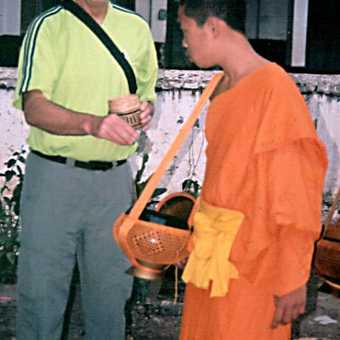 Giving alms to student monks at dawn