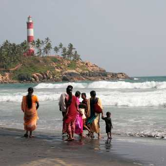 Family day out on the beach, Kovalam, Kerala