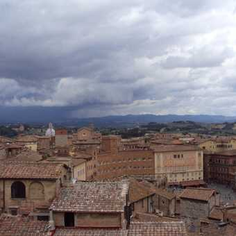 Siena rooftops with approaching storm
