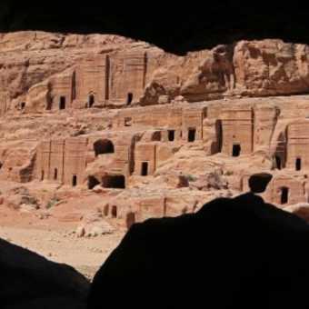 Petra ruin through cave window