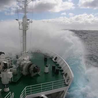 Waves crash over the Vavilov in the rough sea