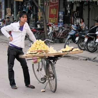 Selling bananas in Hanoi, Nam.  The kids got attitude