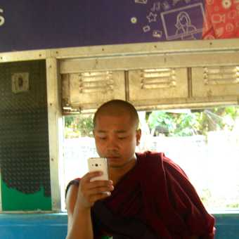 Monk on his mobile!