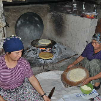 Mother and Grandmother make us bread.