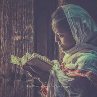 A girl with The Bible (in the Debre Birhan Selassie Church, Gondar)